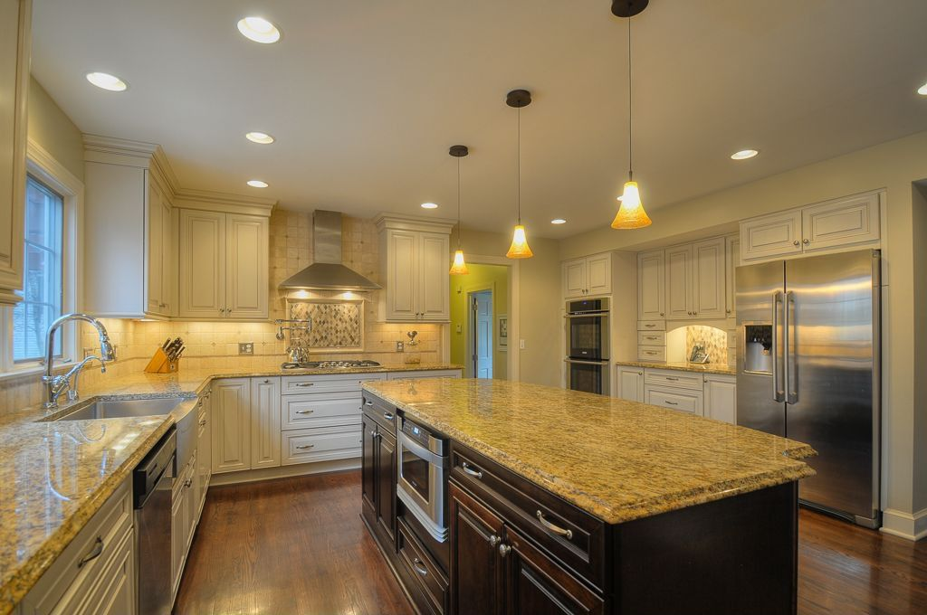Traditional Kitchen with 'athena' bronze 1-light mini pendant, Flush, Farmhouse sink, wall oven, dishwasher, can lights