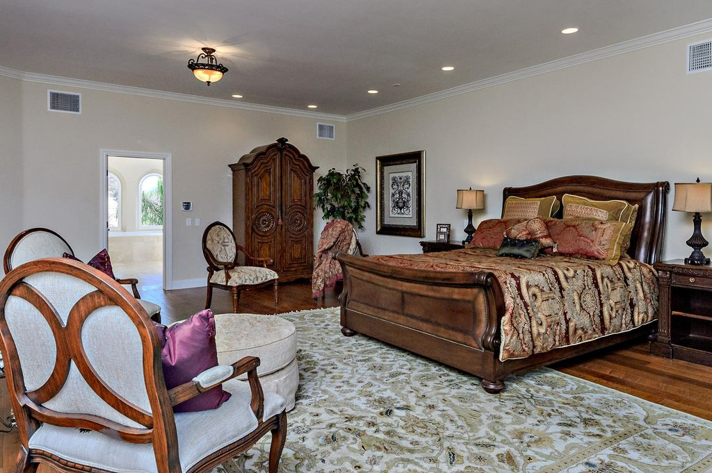 Mediterranean Master Bedroom with flush light, Standard height, Hardwood floors, can lights, Crown molding