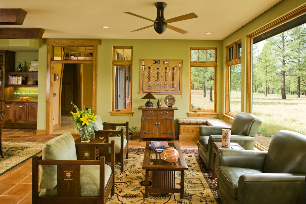"Craftsman Living Room with specialty window, Carpet, Casement, Solistone Terra Cotta 12"" x 12"" Cuadrado Tile in Brown, Paint"