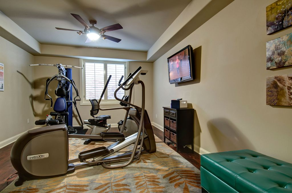 Traditional Home Gym with Ceiling fan, Nautilus E614 Elliptical, Schwinn 230 Recumbent Exercise Bike, Hardwood floors