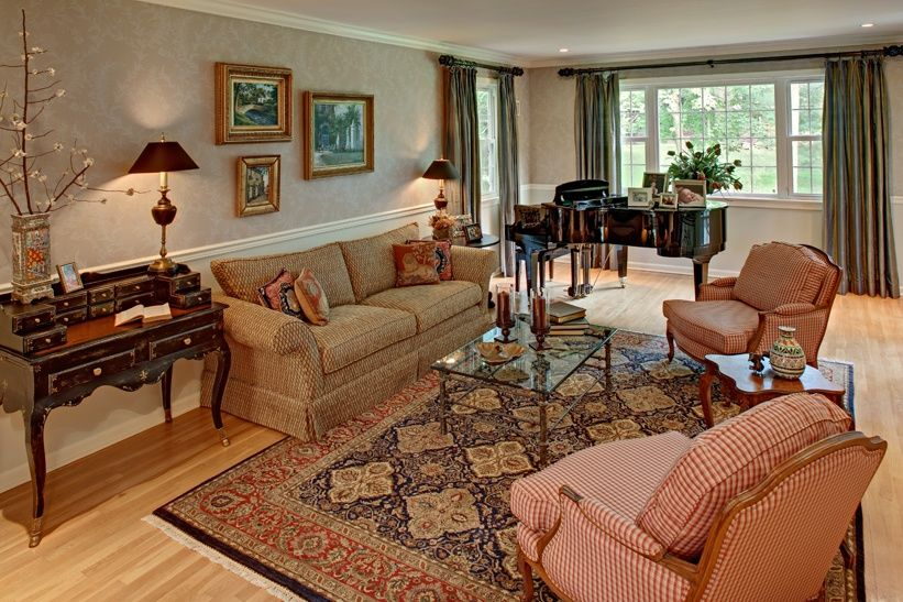 Traditional Living Room with Hardwood floors, can lights, Chair rail, Standard height, interior wallpaper, Wainscotting