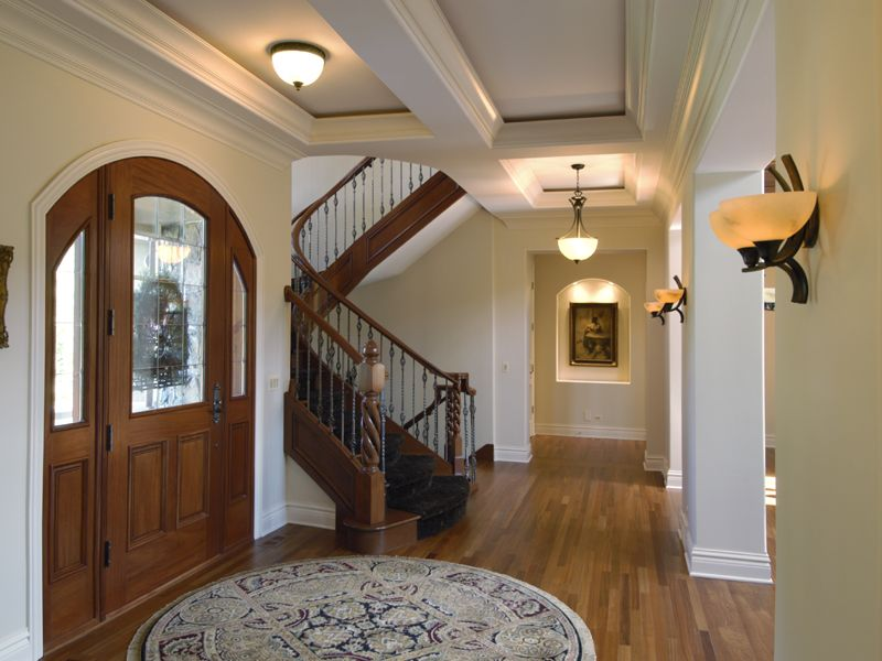 Traditional Entryway with Standard height, Crown molding, Glass panel door, flush light, Box ceiling, Hardwood floors