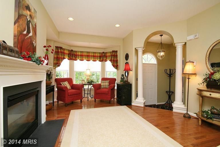 Mediterranean Living Room with metal fireplace, Cement fireplace, Fireplace, Columns, double-hung window, can lights