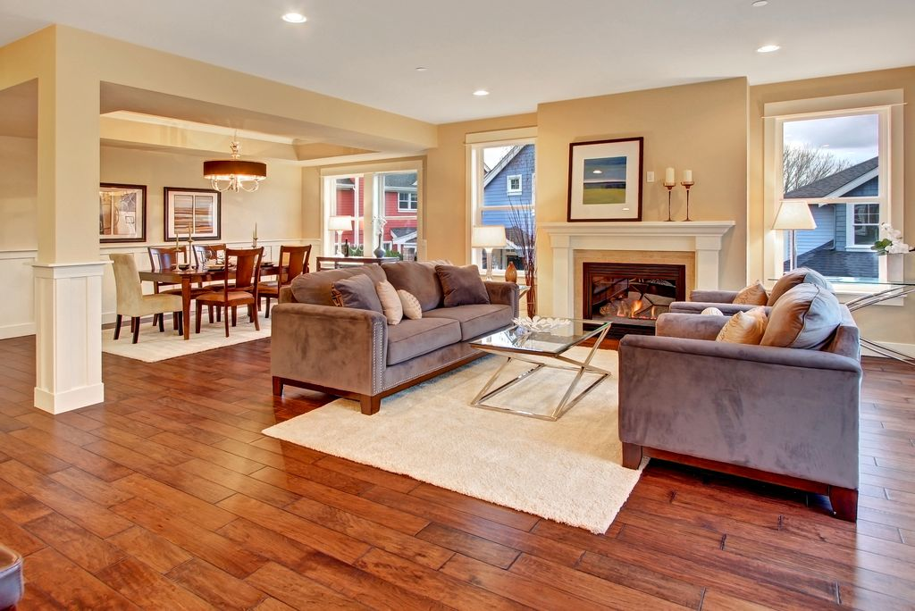 Traditional Living Room with Window seat, Cement fireplace, Fireplace, Columns, can lights, double-hung window