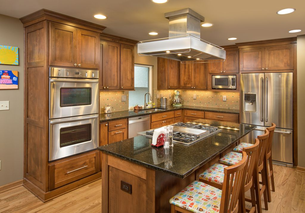 Craftsman Kitchen with Island Hood, Kitchen island, electric cooktop, Built In Refrigerator, Flat panel cabinets, L-shaped