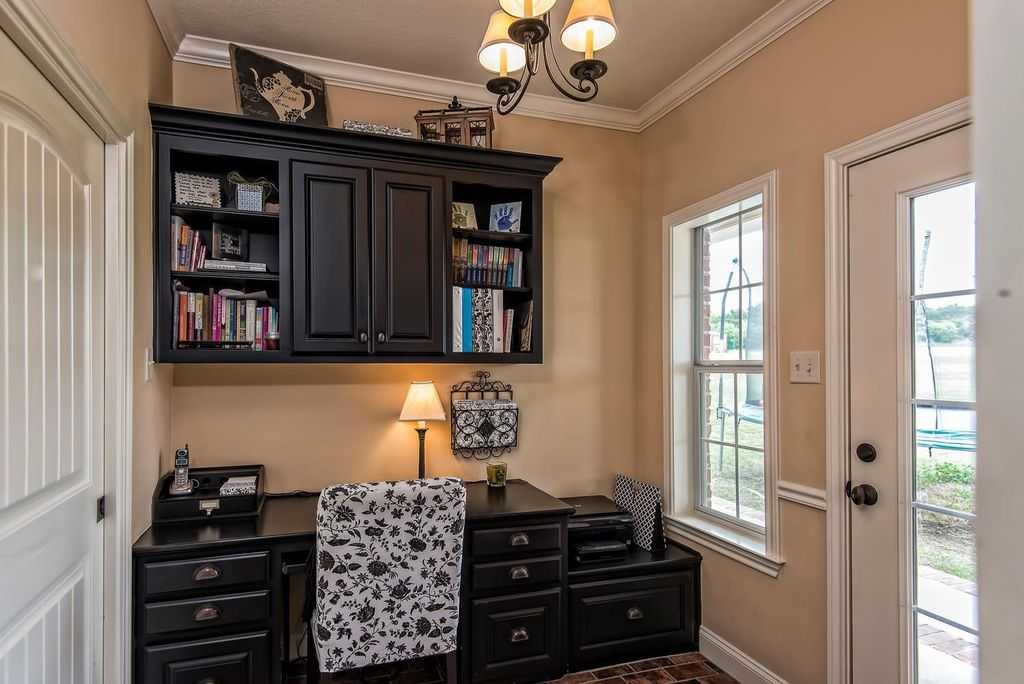 Traditional Home Office with French doors, Chandelier, specialty door, travertine floors, Crown molding, Standard height