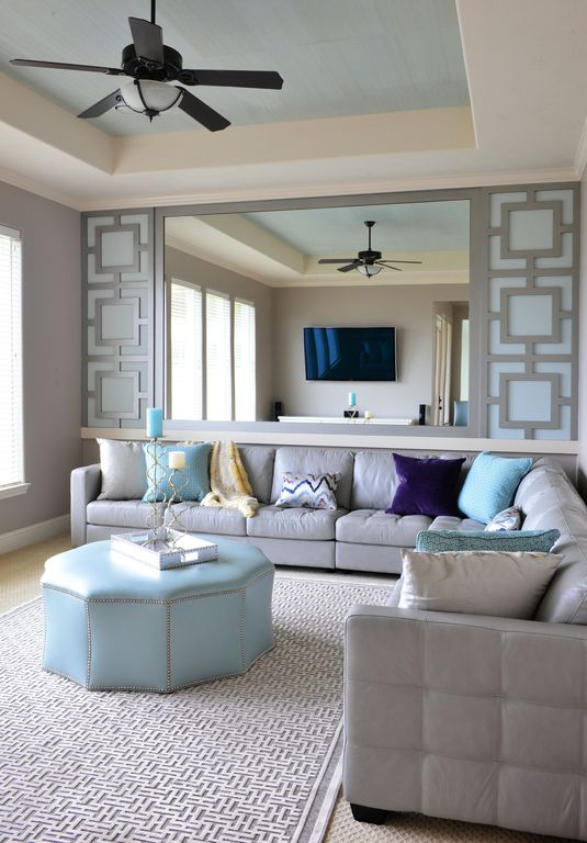 Modern Living Room with Safavieh andrew sky blue tufted round storage ottoman, Carpet, Built-in bookshelf, Standard height