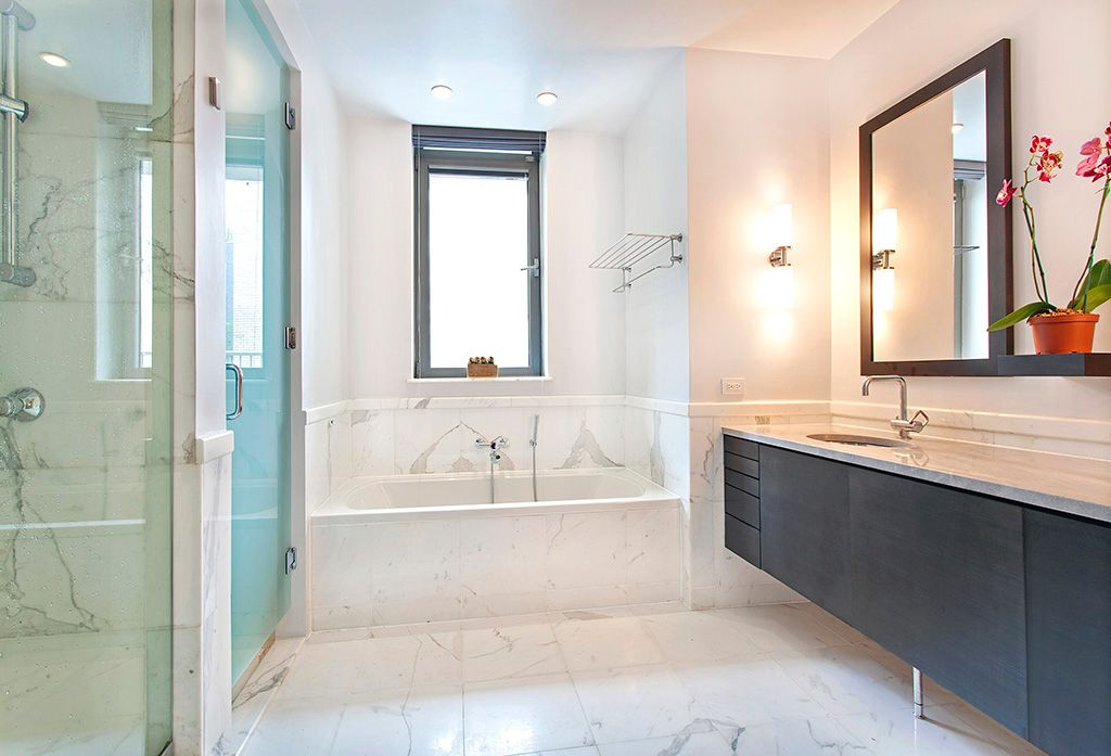 Contemporary Master Bathroom with Wall sconce, frameless showerdoor, Standard height, Sandstone counters, Shower, Flush