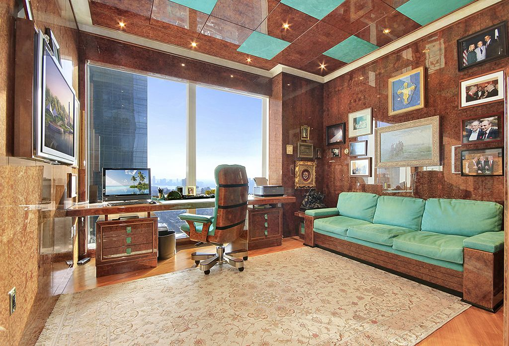 Eclectic Home Office with Crown molding, can lights, Laminate floors, picture window, Standard height