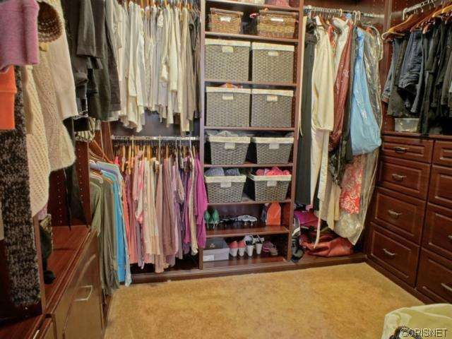 Traditional Closet with Standard height, Built-in bookshelf, Carpet