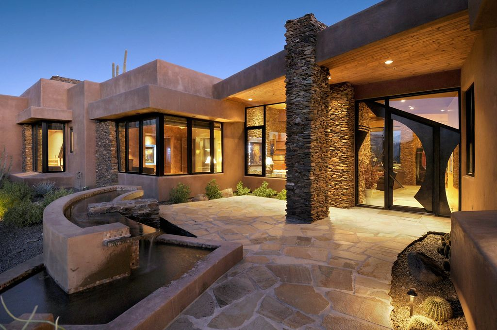 Contemporary Front Door with Pond, French doors, Bird bath, picture window, exterior stone floors, Fountain, Pathway