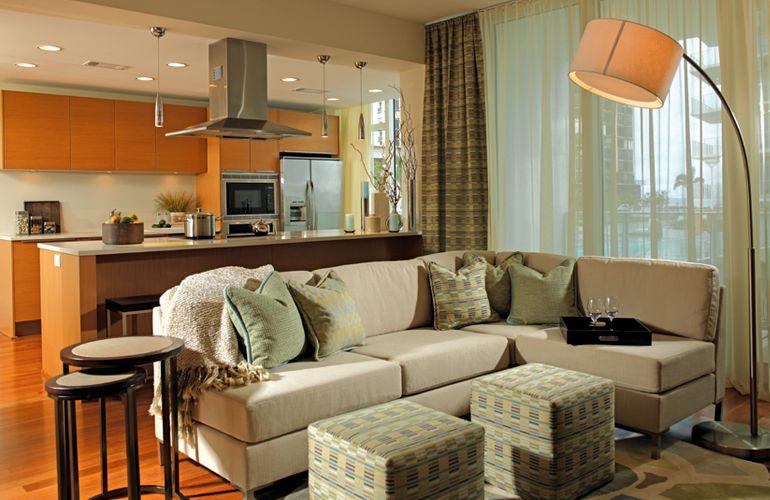 Modern Living Room with can lights, Standard height, Laminate floors, Pendant light, Casement, Built-in bookshelf