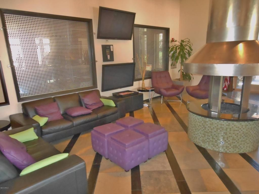 Contemporary Living Room with Standard height, stone tile floors, other fireplace, Fireplace, sandstone tile floors