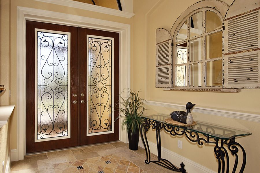 Traditional Entryway with Standard height, limestone floors, French doors, Arched window