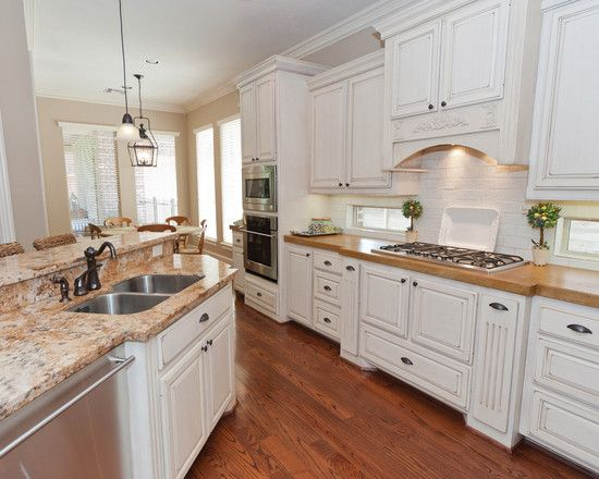 Traditional Kitchen with Breakfast bar, MS International Giallo Napolean Granite, Standard height, Complex granite counters