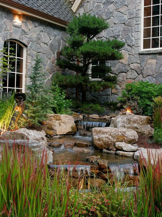 Rustic Landscape/Yard with Water feature, Exterior stucco walls