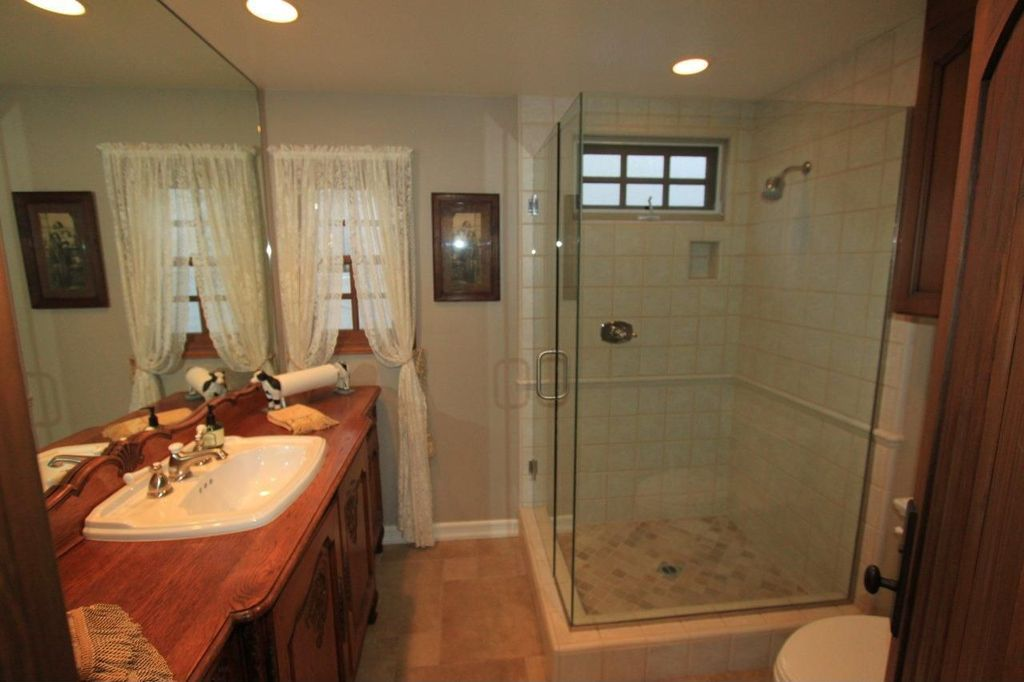 """Cottage 3/4 Bathroom with Torreon Stone Tumbled (Tumbled 4""""x4""""), Natural Stone By Arizona Tile, Rain shower, Wood counters"""