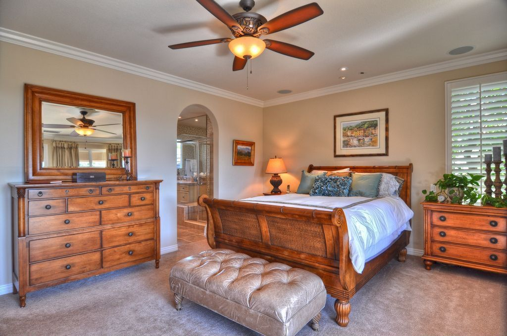Craftsman Guest Bedroom with Crown molding, Carpet, Ceiling fan, can lights, flush light, Standard height, Casement