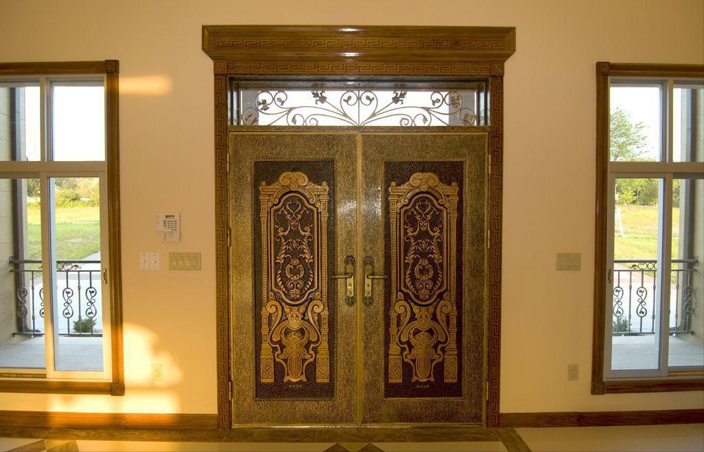 Eclectic Front Door with exterior stone floors, Transom window, Deck Railing, Pathway, Casement