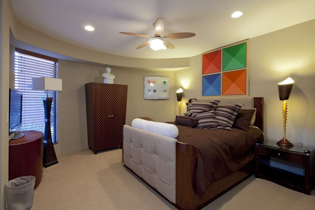 Modern Guest Bedroom with flush light, Carpet, can lights, Standard height, Ceiling fan, picture window, Casement