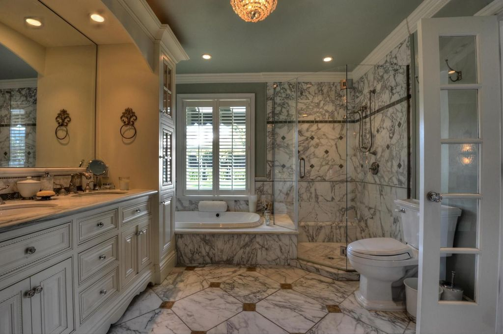 Traditional Master Bathroom with Double sink, can lights, Complex marble counters, Crown molding, Glass panel door, Casement