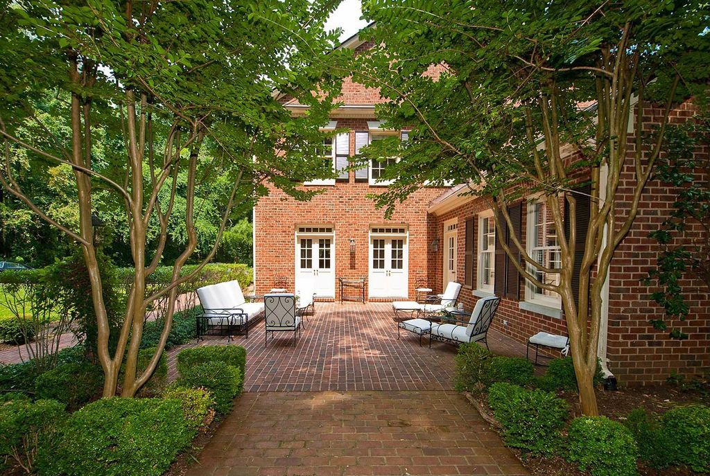 Traditional Patio with Glass panel door, exterior brick floors, Pathway, double-hung window