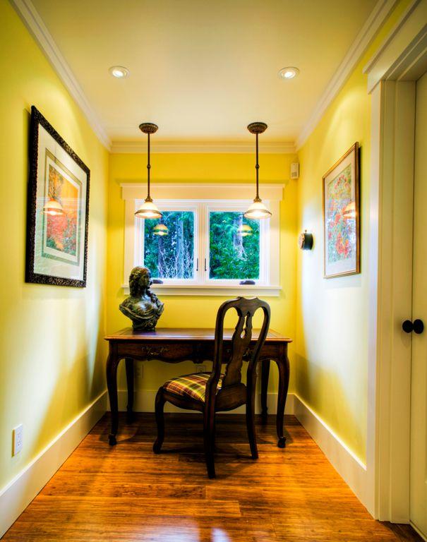 Traditional Home Office with Casement, Standard height, can lights, Pendant light, flat door, Crown molding, Hardwood floors