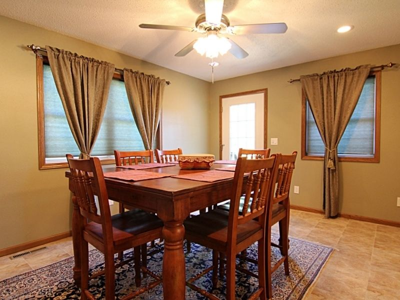 craftsman dining room with flush light ceiling fan in