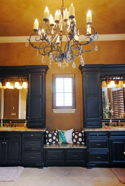 Mediterranean Master Bathroom with Complex Granite, Powder room, Undermount sink, Crown molding, stone tile floors, Casement