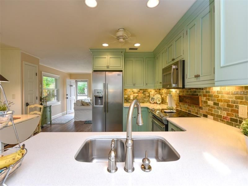 Country kitchen with ceiling fan slate tile in venice for Kitchen cabinets venice fl