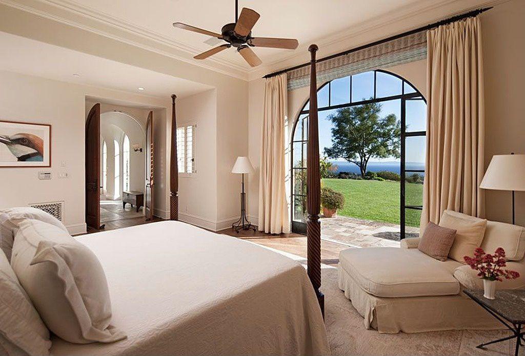 Mediterranean Master Bedroom with Hardwood floors, French doors, Crown molding, Casement, can lights, Ceiling fan