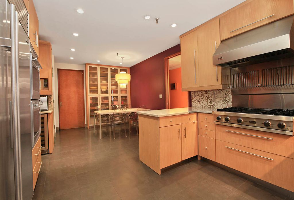 Contemporary Kitchen with Standard height, Built In Refrigerator, limestone tile floors, electric cooktop, built-in microwave