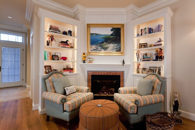 Traditional Living Room with Built-in bookshelf, brick fireplace, Crown molding, Standard height, Fireplace, Paint 2, Paint 1