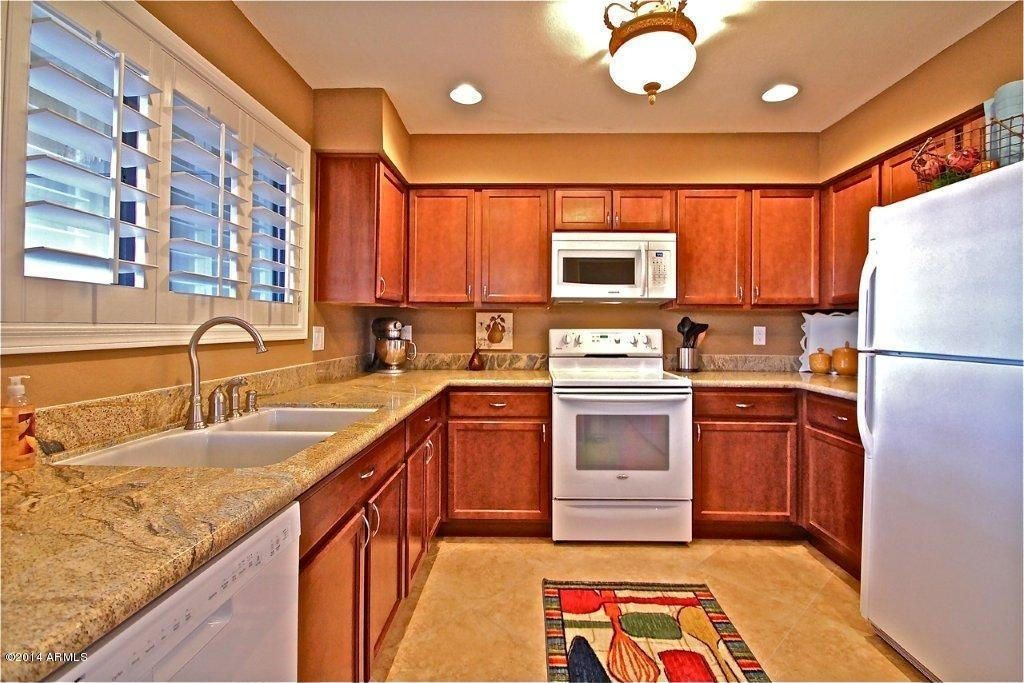 Kitchen with Complex granite counters, Shaw living - 2 ft. x 3 ft. utensil kitchen rug, Paint 2, built-in microwave, U-shaped
