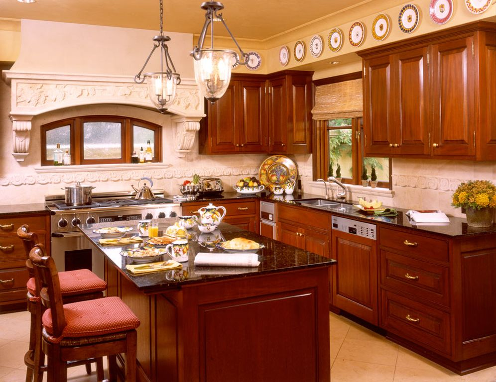 Mediterranean Kitchen with Standard height, gas range, L-shaped, can lights, Stone Tile, Crown molding, dishwasher, Casement