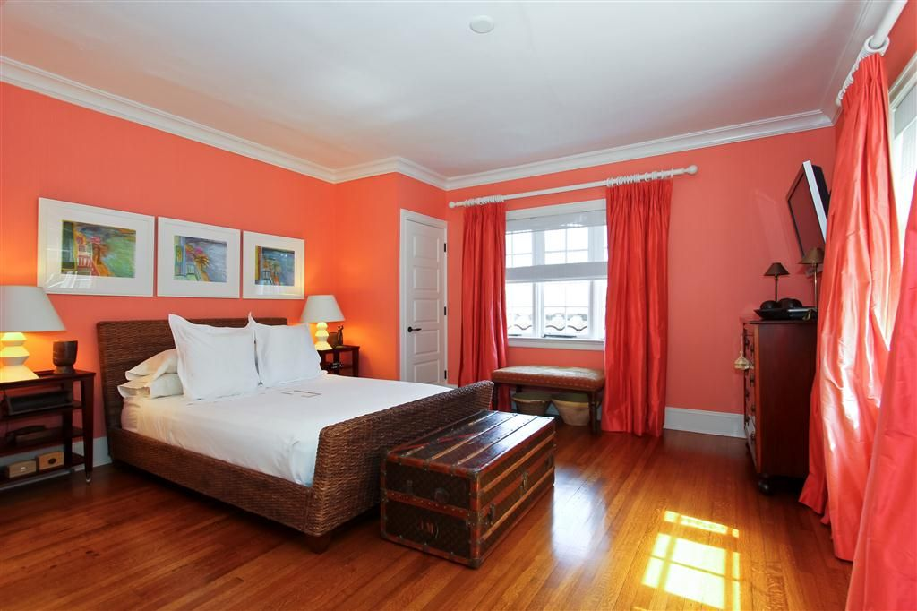 Tropical Guest Bedroom with Standard height, Hardwood floors, Crown molding, specialty door, double-hung window
