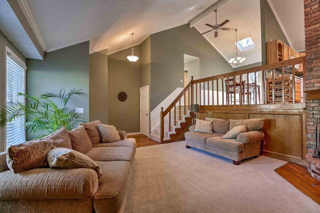 Country Living Room With Interior Brick Balcony In Kansas City MO Zi