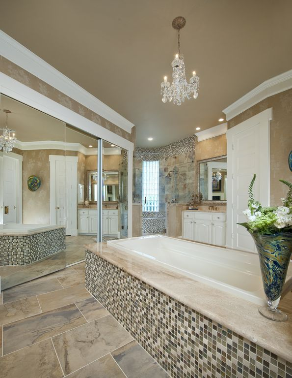 Traditional Master Bathroom with Complex marble counters, Undermount sink, partial backsplash, Raised panel, picture window