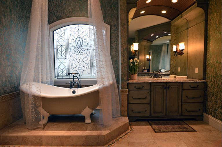 Traditional Master Bathroom with Arched window, Flush, limestone tile floors, Master bathroom, interior wallpaper, Clawfoot