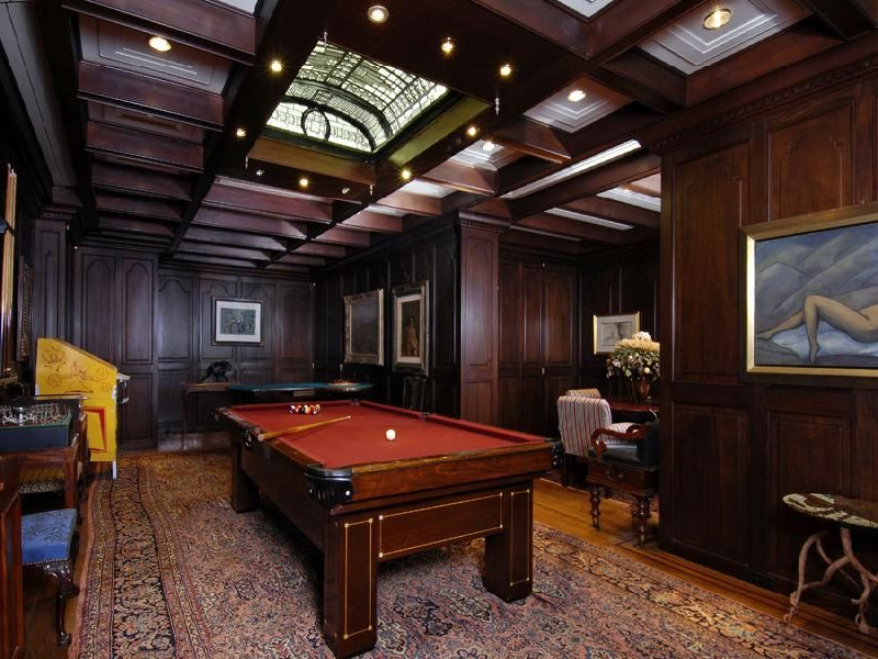 Traditional Game Room with can lights, Cathedral ceiling, Laminate floors, Exposed beam