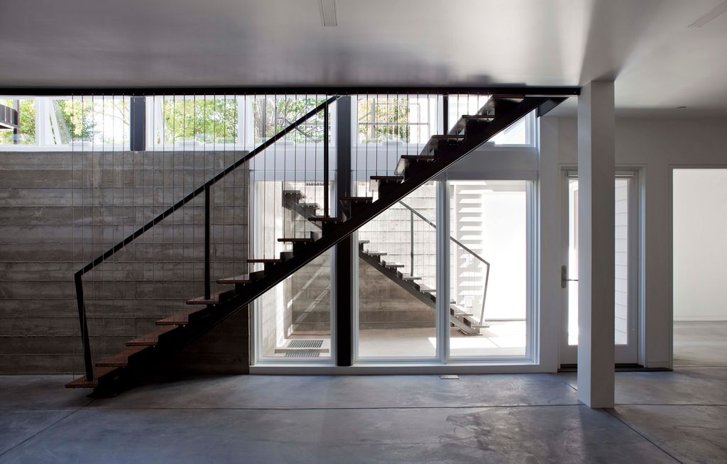 Contemporary Staircase with Standard height, Columns, French doors, picture window, Concrete floors, curved staircase