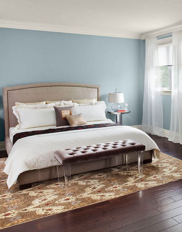 Contemporary Guest Bedroom with Hardwood floors, Crown molding, Standard height, double-hung window