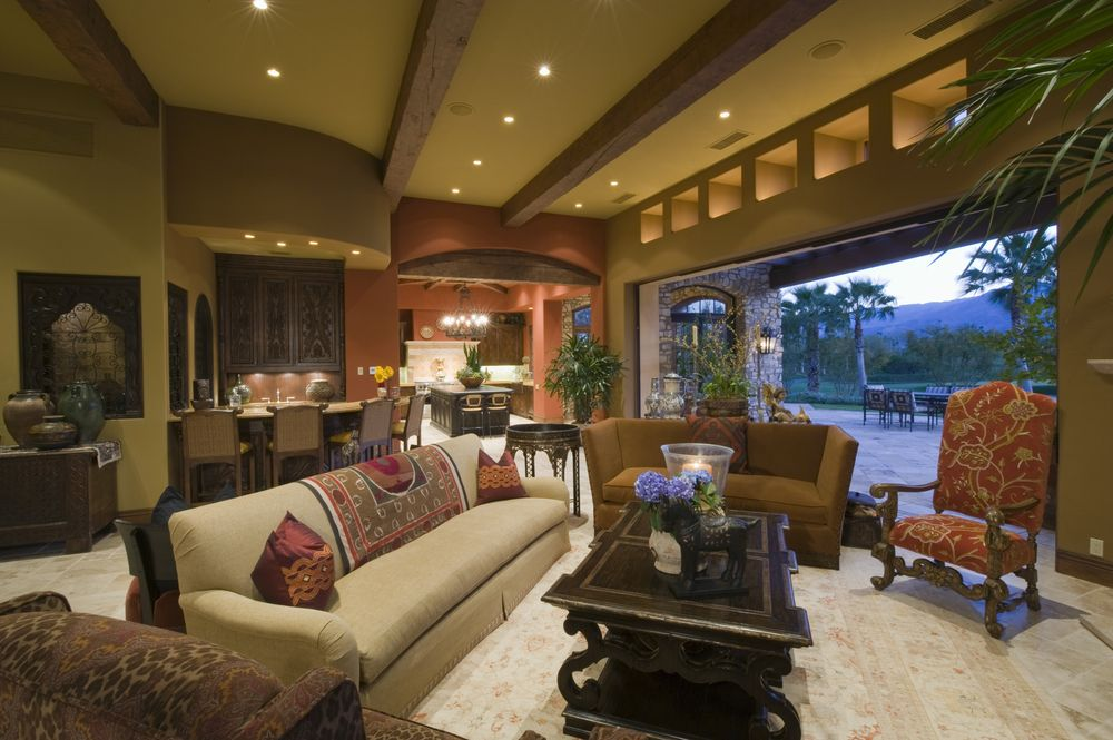 Rustic Living Room with sandstone floors, can lights, Standard height, Exposed beam