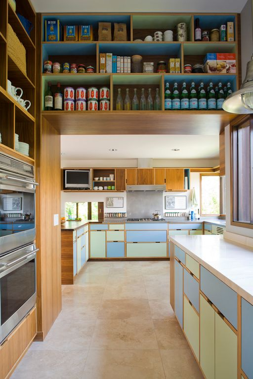 Contemporary Pantry with Built-in bookshelf, Concrete tile , Pendant light, Standard height