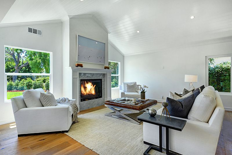 Contemporary Living Room with Standard height, double-hung window, stone fireplace, can lights, Fireplace, Hardwood floors