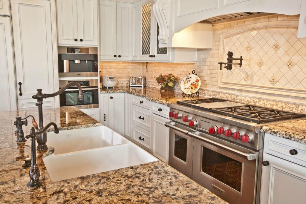 Traditional Kitchen with Custom hood, Multiple Sinks, wall oven, Limestone Tile, L-shaped, Flush, Stone Tile, full backsplash