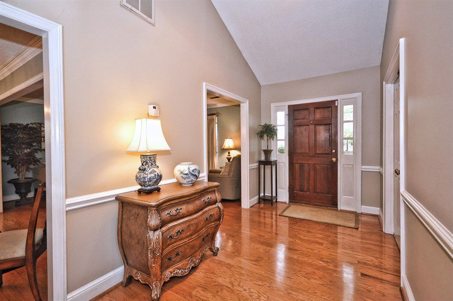 Traditional Entryway with Standard height, Hardwood floors, Chair rail, six panel door