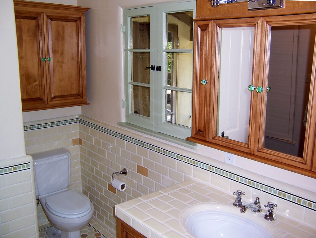 Traditional Kids Bathroom with Framed Partial Panel, penny tile floors, Standard height, large ceramic tile counters