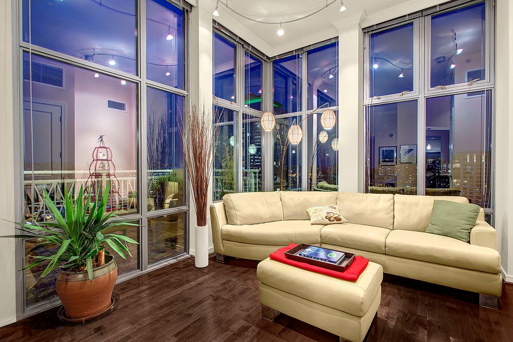 Contemporary Living Room with Standard height, Hardwood floors, flush light, Casement, picture window