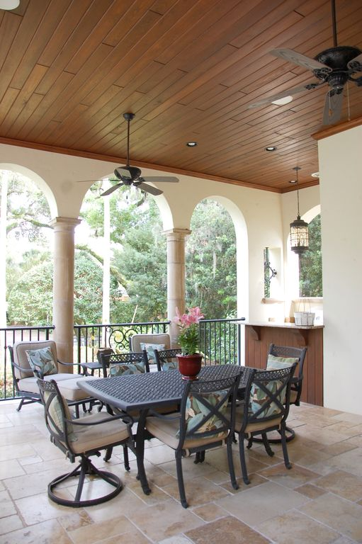 Traditional Patio with exterior stone floors, Deck Railing